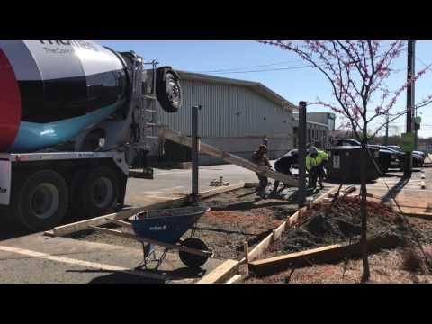 Dumpster enclosure installation - charlotte nc - pipe bollard installation